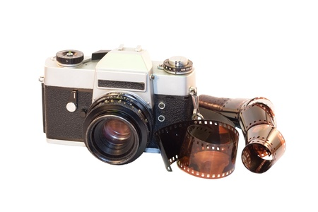 old camera with film on white background photo
