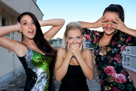 Girls in three different expression, no see, no hear and no talk photo