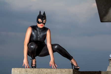 Beautiful woman in  leather latex on the roof Stockfoto