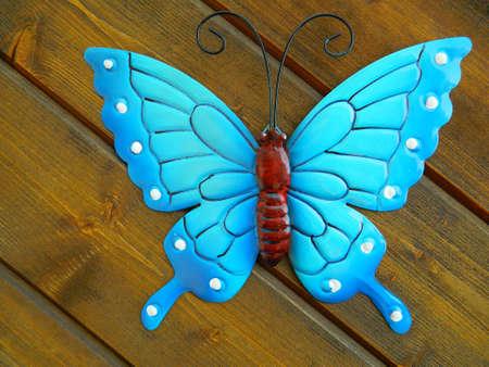 butterfly in the garden: Blue Butterfly Garden Decoration Stock Photo