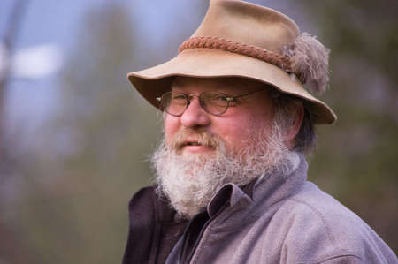 This photo is a Caucasian middle aged hillbilly rugged mountain man type person.  Raggy gray beard and rustic hat top the look. Stock Photo - 4631974
