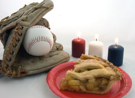 This all American photo features baseball mit and ball, slice of fresh apple pie on a red plate, and red white and blue votive candles.