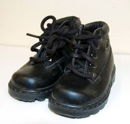 A photo featuring a pair of toddler black boots.