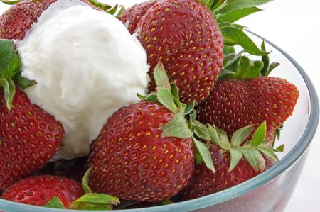 dollop: This closeup shot is a clear bowl of fresh strawberries and a dollop of whipped cream. Stock Photo