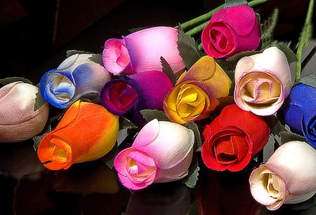 These are handmade roses from wood in a multi colored bouquet on a black background. Stock Photo - 5045629