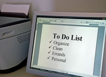 errands: This home office has a To Do list on the computer monitor screen.