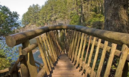 flattery: This beautiful scenic lookout overlooks an ocean from a mountain view at Cape Flattery Washington.