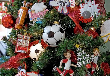 This Christmas tree has a sports theme going, with soccer being the main point, with soccer ball lights.