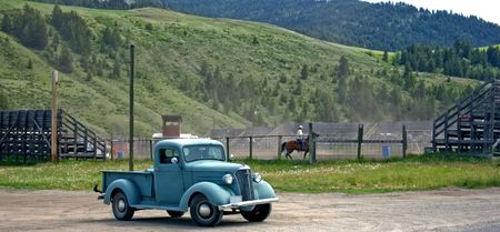 This shot shows a small town authenic rodeo complete with a cowboys old truck. photo