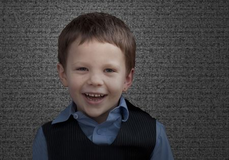 Cute litte 5 year old Caucasian boy happy and smiling with textured background. photo