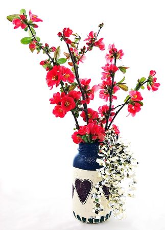 quince: This Americana primitive type vase is filled with flowering quince coral colored floweres, with some gold metallic filled trailing on the sides.  This still life is a 4th of July theme.