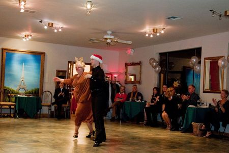 EVERETT, WA - DECEMBER 13, 2009: An unidentified couple, older lady with rudolph costume dances.  Dancing is an excellent form of exercise and helping to stay young and fit.  Silver Ball on Silver Lake event was held on December 13, 2009 in Everett, WA.