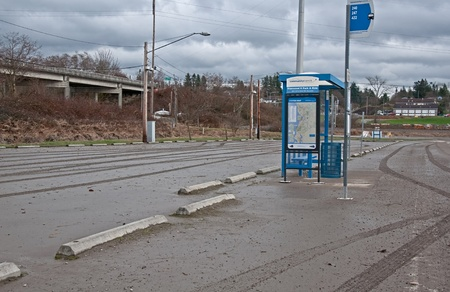 STANWOOD, WA – DECEMBER 14: - Flood waters from Stillaguamish river poured over recently and left a muddy mess at this bus stop.  The natural disaster took place December 14, 2010 in Stanwood, Wa.