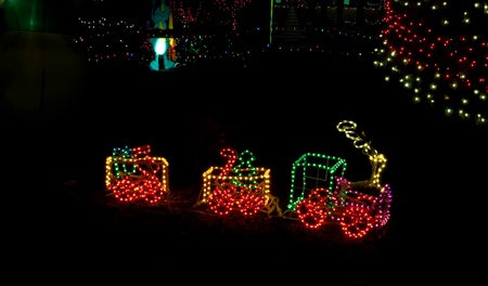 this little toy train is in christmas lights at night against a dark background with other - Christmas Light Train