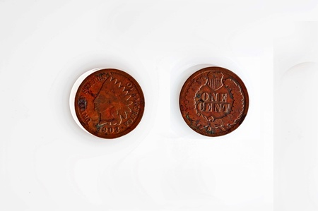 This stock image is an American 1903 Indian head and tails currency of a penny, isolated on a white background.  Circa 1900 money.