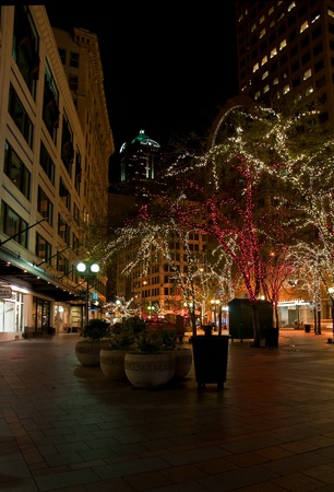 This stock image is of downtown Seattle, WA in King County, at Christmas time with city trees decorated in Christmas lights at light.