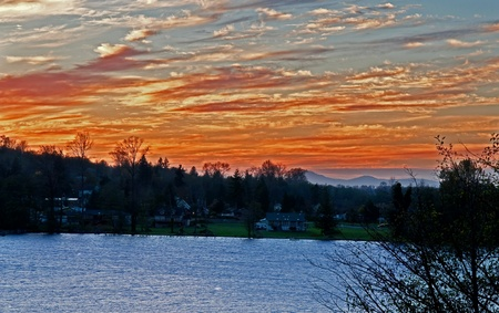 This stock image is a beautiful sunset at a lakeside community in Clear Lake Washington in Skagit County. Stock Photo - 11104817