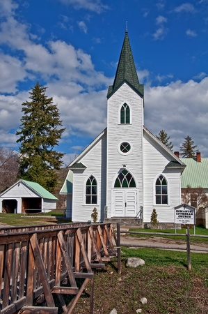 This white classic turn of the century church was built in 1917 and is located in Havillah Washington in Okanogan County.  It photo