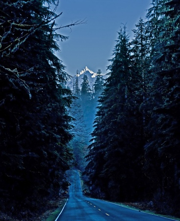 mt baker: a country road leading through mountains, to Mt. Baker Washington, on a winter early dawn morning.