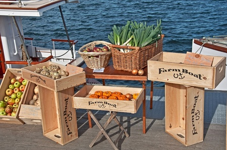 SEATTLE- NOVEMBER 9:  Fresh produce is sold at Lake Union's Floating Farmers Market aboard the historic Virginia V ship. It was originally built to transport farm products from Vashon Island to Pike Place Market in 1922.  Held on November 9, 2010 in Sea