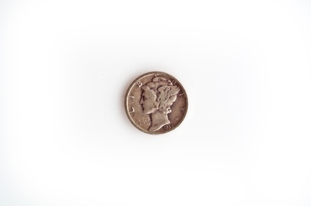 dime: This is a vintage, circa 1930 silver US mercury dime, head closeup, isolated on a white background.