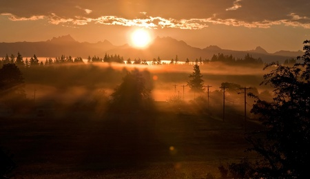 def: stunning sunrise over the mountain known as 3 Sisters or 3 Fingers (called both commonly) in Washington