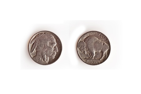 This stock image is a US nickel, circa 1920 (1928) heads and tails of an Indian head, buffalo silver nickel, isolated on a white background.  This vintage American coin is a collectible for many.