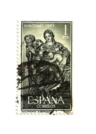 postmark: SPAIN - CIRCA 1963 - This vintage postage stamp is a Christmas stamp depicting the holy family rich with Spanish cultural art. Nostalgic Spanish object circa 1963.