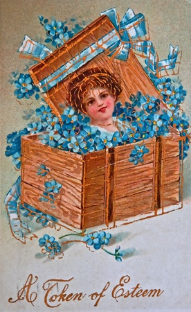 USA- CIRCA 1900 - This aged vintage greeting card is showing signs of age, with forget me not flowers, and words