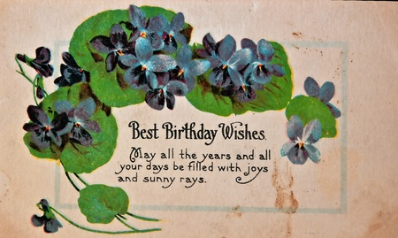 birthday wishes: CIRCA 1900 - This aged vintage greeting card with has a birthday message on worn, aged and dirty paper.   Nostalgic American object for personal communication in the early 1900 Editorial