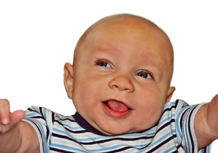 This darling 4 month old baby boy is bi-racial, bald with blue eyes, smiling and happy on a white background   He photo