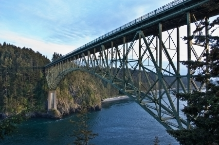 This large steel bridge is over treacherous channel water in this landscape image of Deception Pass, located in Island County, Washington State, America