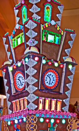 This massive candy gingerbread house is a large, intricate tower with candy windows, doors and much more set in a vertical format   Great holiday image