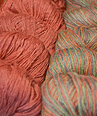 Two closeup skeins of salmon colored yarn are next to each other, one is a multi-toned   Textile is used in many crafts and other projects   Vertical with no people in the image Reklamní fotografie - 14883948