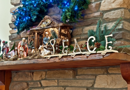 This Christmas still life is on a rock fireplace mantle with the word  Imagens