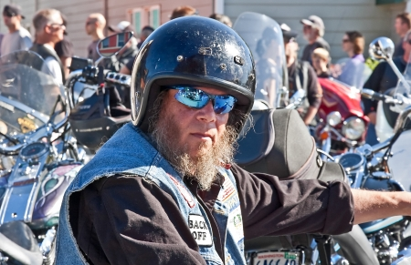ANACORTES, WA - SEPTEMBER 27: An unidentified biker man with motorcycle rides in the 28th annual Oyster Run largest motorcycle run in the Pacific Northwest on September 27, 2009 in Anacortes, WA. Stock Photo - 15240237