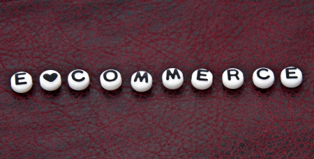 e commerce: This is one in a part of series, with the word E Commerce written with letter beads on a black and red leather background   Many usages for this textured design