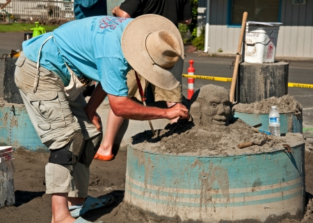 LONG BEACH, WA - JULY 20 - Master sandbuilders come to compete in the annual Sandsation competition, this unidentified man is making his art.  Held on July 20, 2011 in Long Beach, WA Stock Photo - 15838271