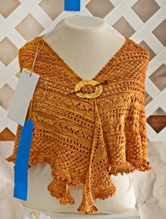 hand crafted: This hand knitted gold colored shawl is a blue ribbon winner of a county fair  Stock Photo