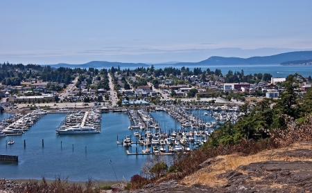 skagit: This is an aerial landscape of Anacortes Washington, overlooking the marina   Puget Sound and the San Juan Islands are in the distance   Beautiful, small coastal town in Skagit County, Washington state  Stock Photo
