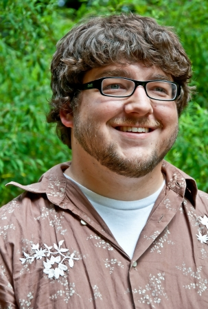 early twenties: This Caucasian young adult male is in his early twenties in this outdoor portrait   He