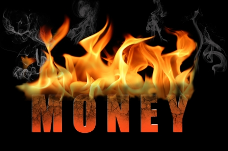 burning money: The word money is in flame text to convey many different messages and concepts about burning money   Applies to business and industries as metaphors   Black background