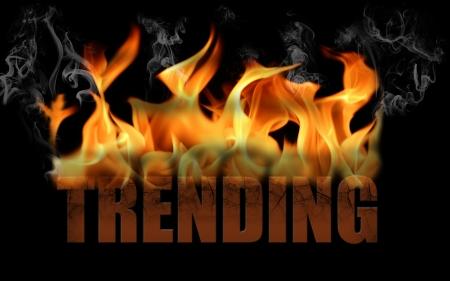 trending: Questa � la parola trend nel testo di fuoco con ondate di fumo rotolare fuori la fiamma e la parola � incrinato orizzontale su uno sfondo nero