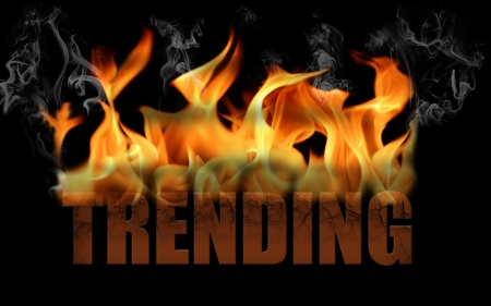 business trending: This is the word trending in fire text with billows of smoke rolling off the flame and the word is cracked   Horizontal on a black background