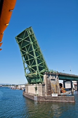 This is the Fremont drawbridge in Seattle, WA, lifted up from Lake Union perspective   It photo