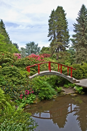 Stock Photo   This Serene And Peaceful Landscape Is A Japanese Garden Theme,  With A Little Red Bridge Arching Over Some Water Quiet, Solitude For A  Peaceful ...