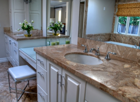 contemporary bathroom with large vanity and sink areas in neutral colors