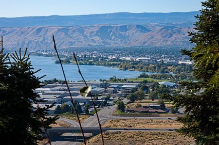 Aerial landscape of Wenatchee Valley Washington with the Columbia river running through the valley. Cityscape with streets and mountains. Wenatchee is found in Chelan County in the Pacific Northwest.