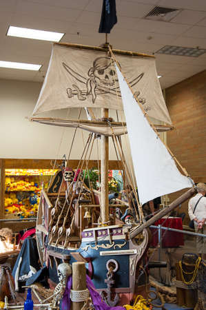 Puyallup, WA USA September 10, 2015:  Pirate ship display with skeletons and a pirate symbol on the mast, at Evergreen State fair. Redactioneel