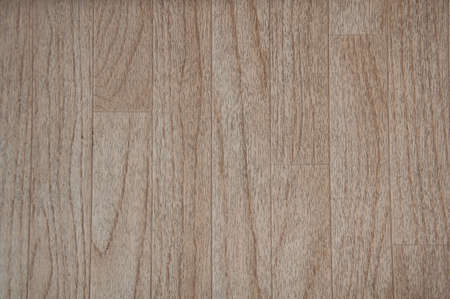 Wood floor background in medium color wood grain with planks running vertically. Great for backgrounds, textures and design elements.